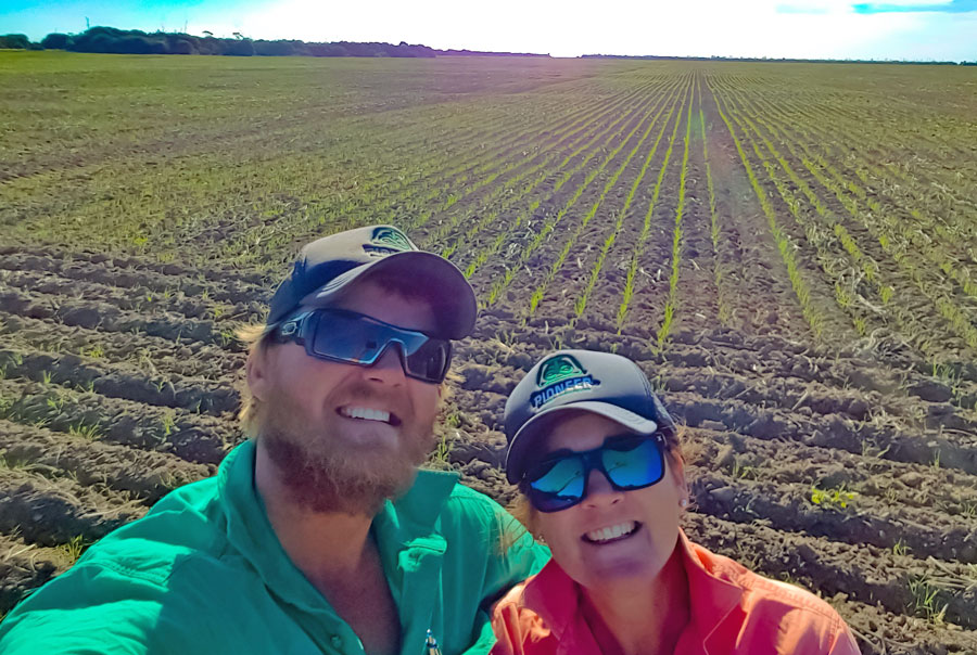 Jake and Felicity Hamilton picture in a growing crop. Both are smiling at the camera