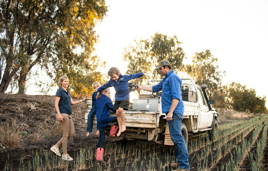 Luke and Sophie Bradley with their children in a ute