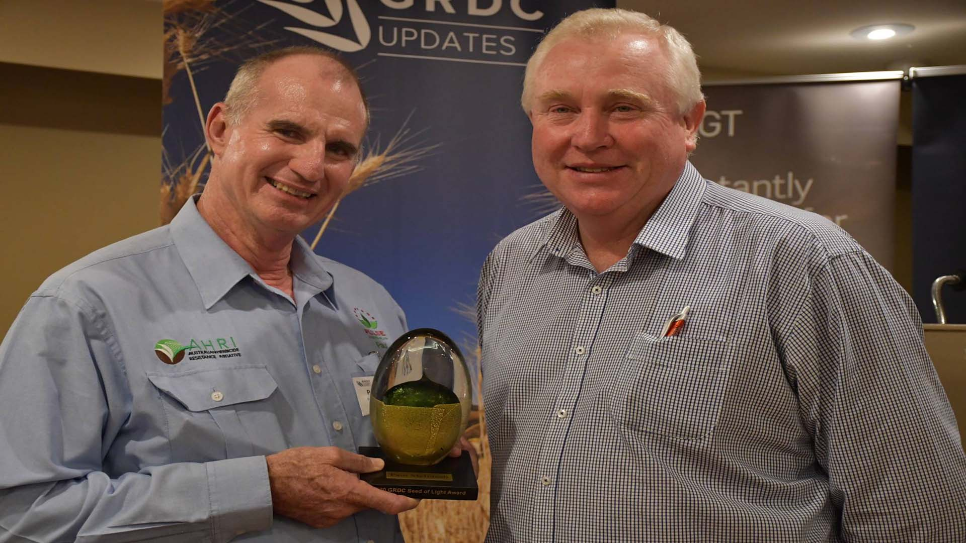 Well-known agronomist Paul McIntosh, left, was acknowledged for his tireless dedication to the grains industry with the GRDC northern region 2020 Seed of Light Award - presented by GRDC Northern Region Panel chair John Minogue, right, at the GRDC Grains Research Update in Goondiwindi.