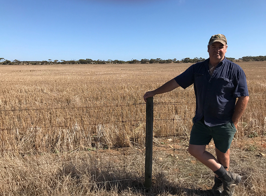 Scott Crettenden with a paddock of ameliorated non-wetting sand on his property at Karkoo, South Australia.