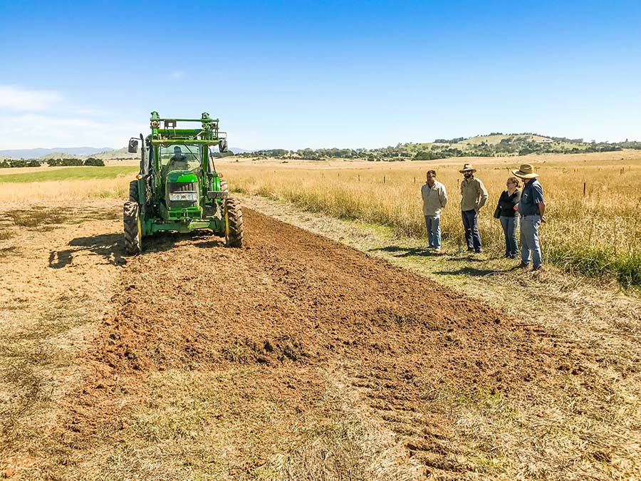 ANU and CSIRO PhD student Elizabeth Coonan, third from left, and other researchers setting up the trial for her two-year doctorate. A rotary hoe was used to mix pasture residues and lime through the topsoil. PHOTO John Kirkegaard, CSIRO