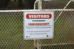 Biosecurity gate signs alert visitors to farm biosecurity zones