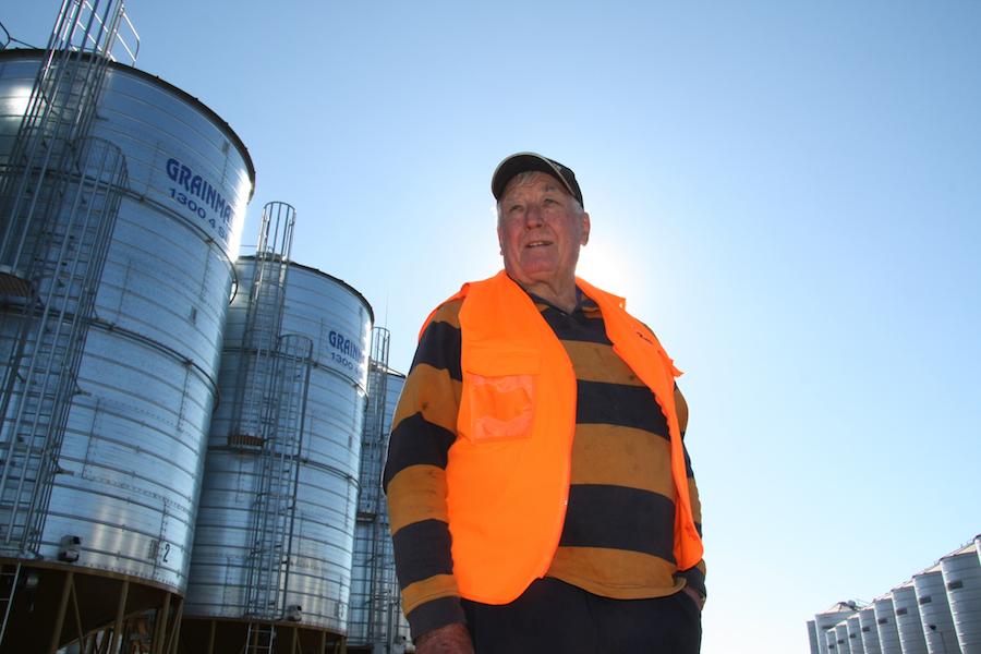 Wayne Anderson standing among silos at the on-farm grain storage facility.